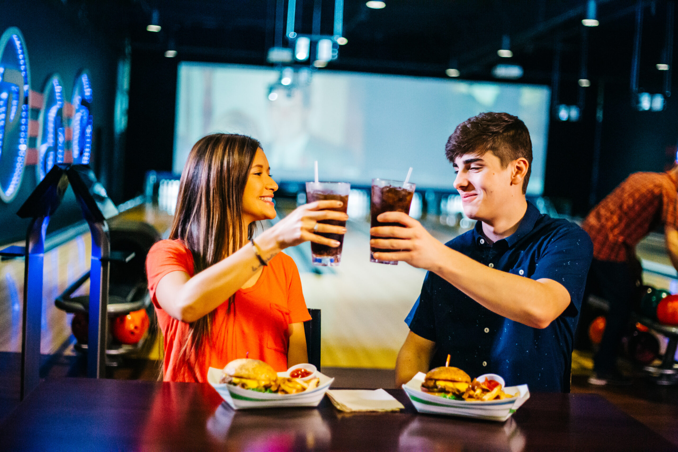 drinks and bowling | couple drinking soda while bowling | open bowling deals | Odyssey Fun Center